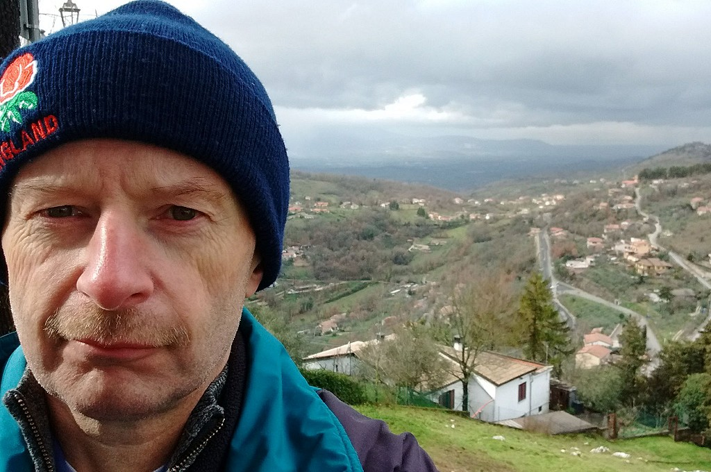 Me, looking a bit tired, with Italian countryside view behind